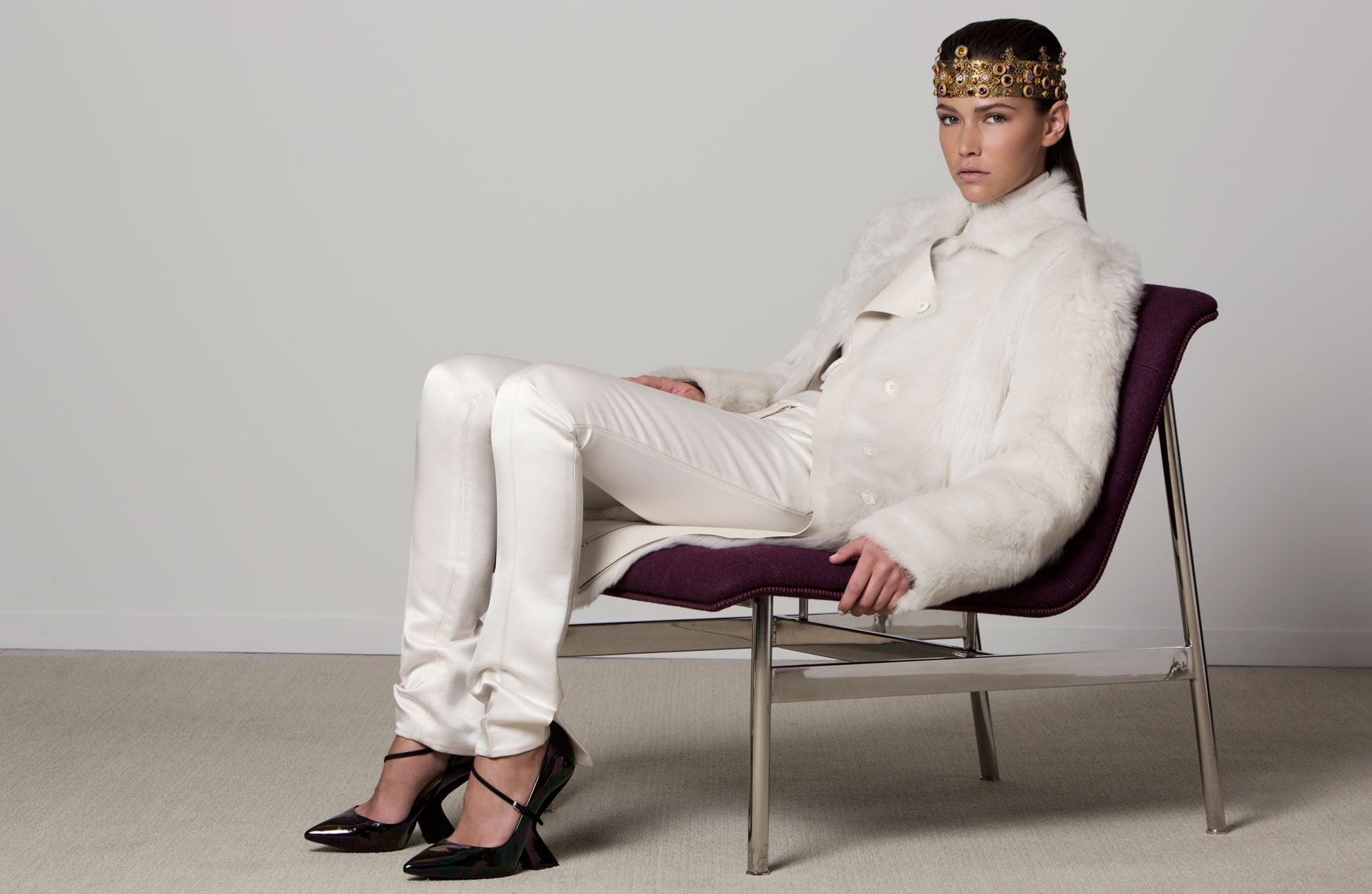 seated fashion model in white for lookbook